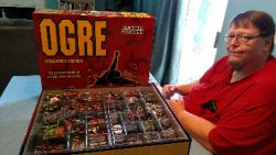 Ogre comes in a HUGE box with dozens of cardboard miniatures to place on the field of battle.