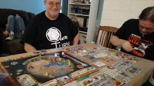 Frank in an Our Turn Podcast T-shirt and playing Terraforming Mars.
