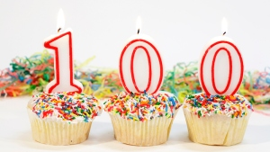 Home made party cupcakes with the number 100 candles on top. Other images of cakes are available for viewing in the
