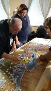 Frank & CJ placing their pieces on the large game board.